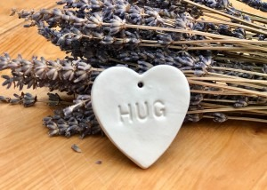 Porcelain heart stamped with 'HUG'