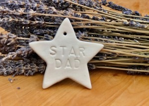 "Porcelain Star stamped with "" Star Dad'"