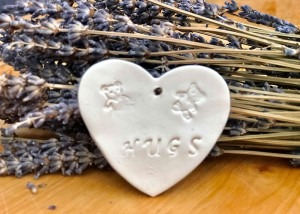 Porcelain Heart stamped with two small teddy bears and the word hugs