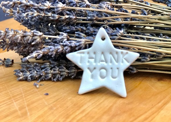 Handmade porcelain star stamped with 'thank you'